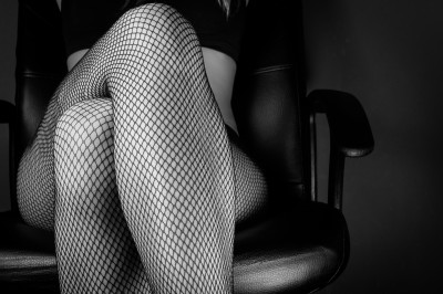Tamsin Flowers's bio pic - black and white of woman crossing legs