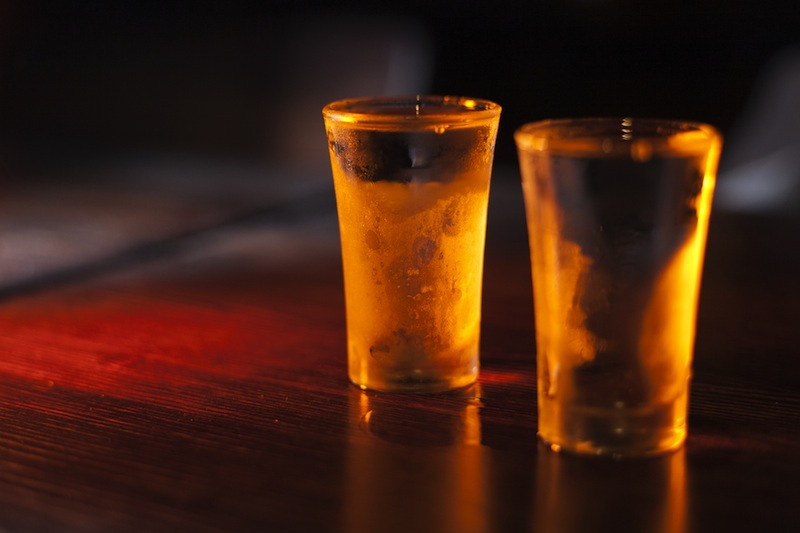 Shadowy image of two shots of gin