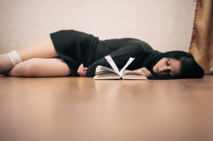 Picture of woman lying on floor looking reading