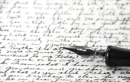 B/W image of calligraphic pen resting on handwritten note; Steve Collender ©123RF.com